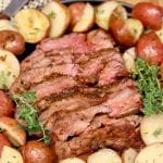 Grilled Tri-Tip Steak sliced on a platter with potatoes - text overlay