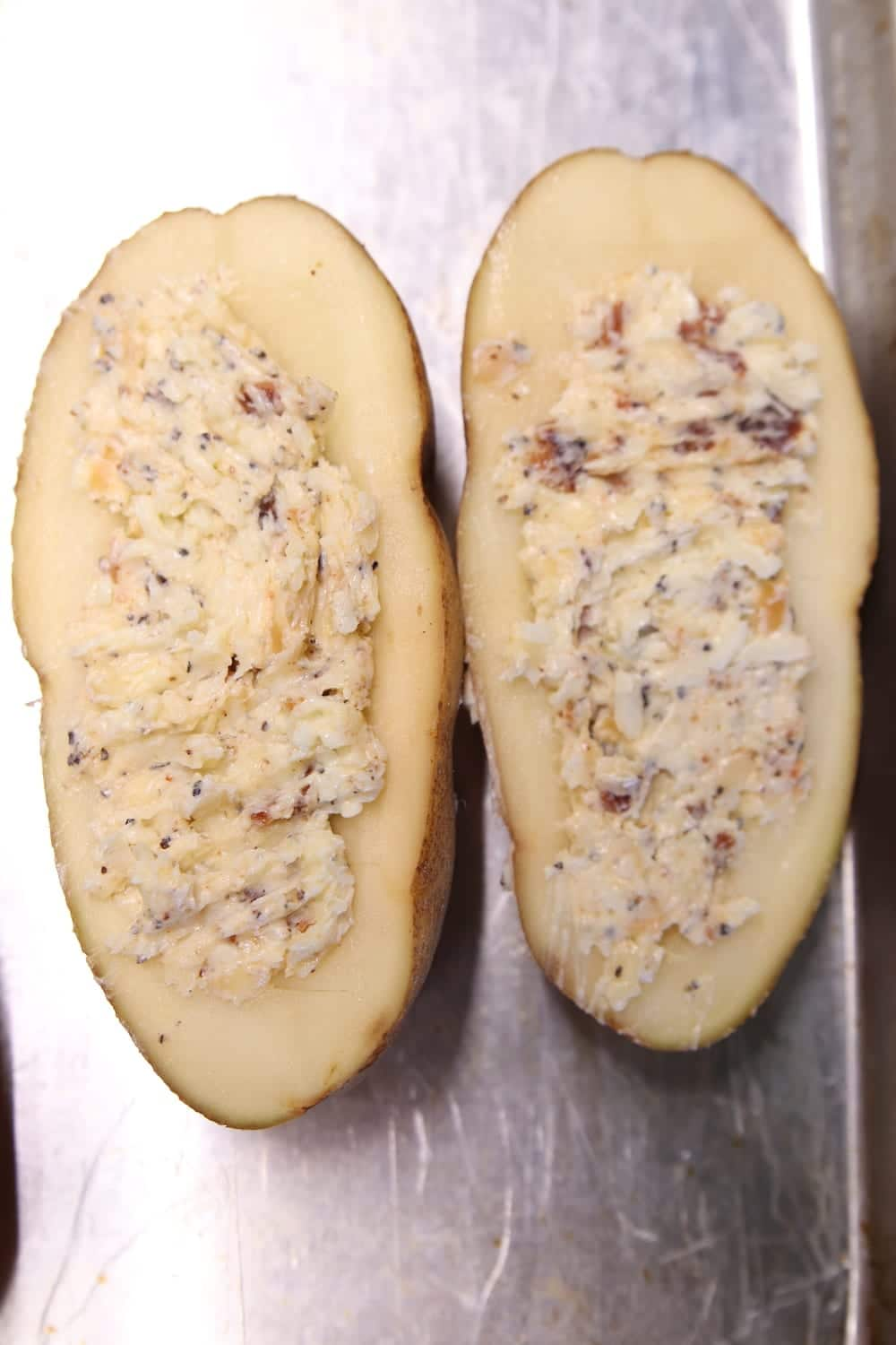 russet potato cut in half, stuffed with bacon, cheese and butter