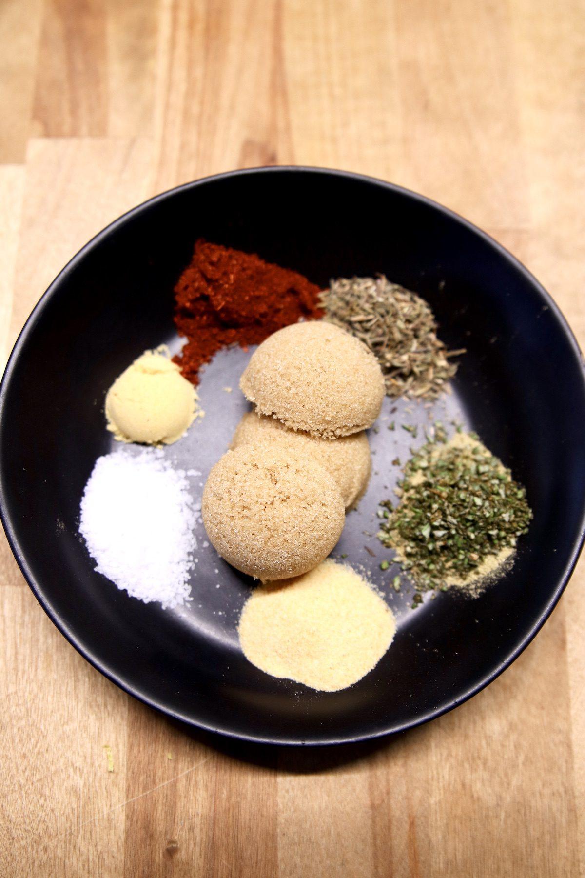 seasonings in a black bowl for fish rub