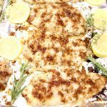 lemon grilled fish on foil with lemons and thyme