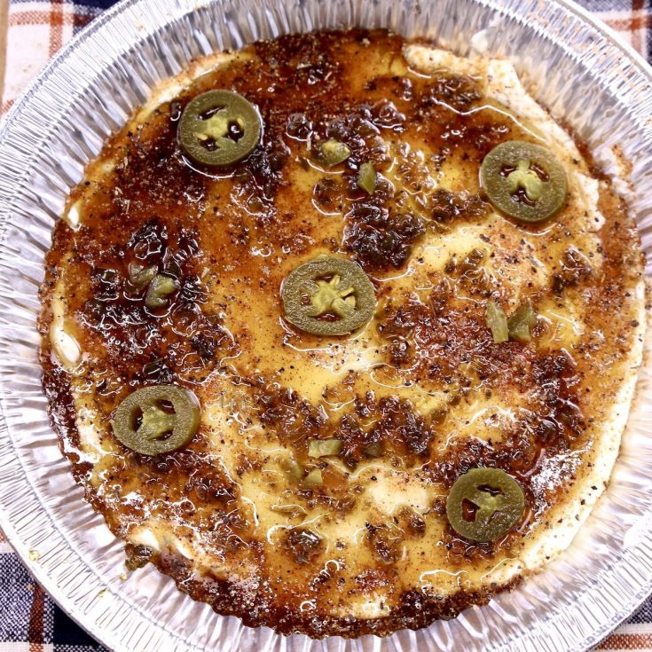 cream cheese dip with jalapenos in a foil pan