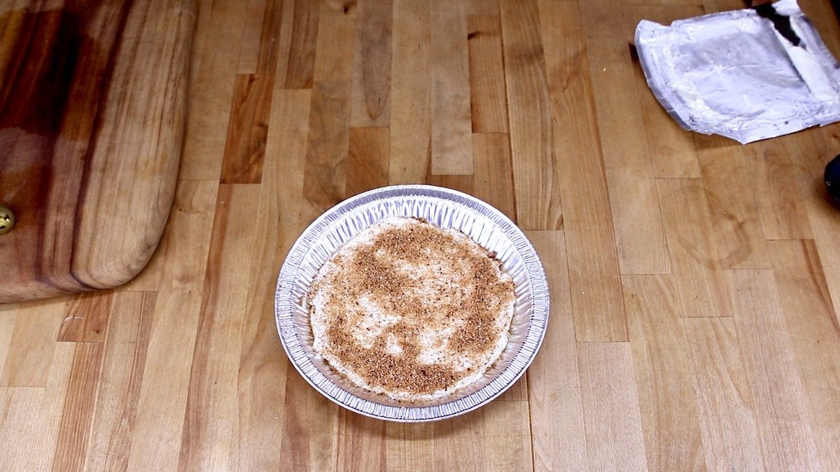 cream cheese with steak rub in a pan