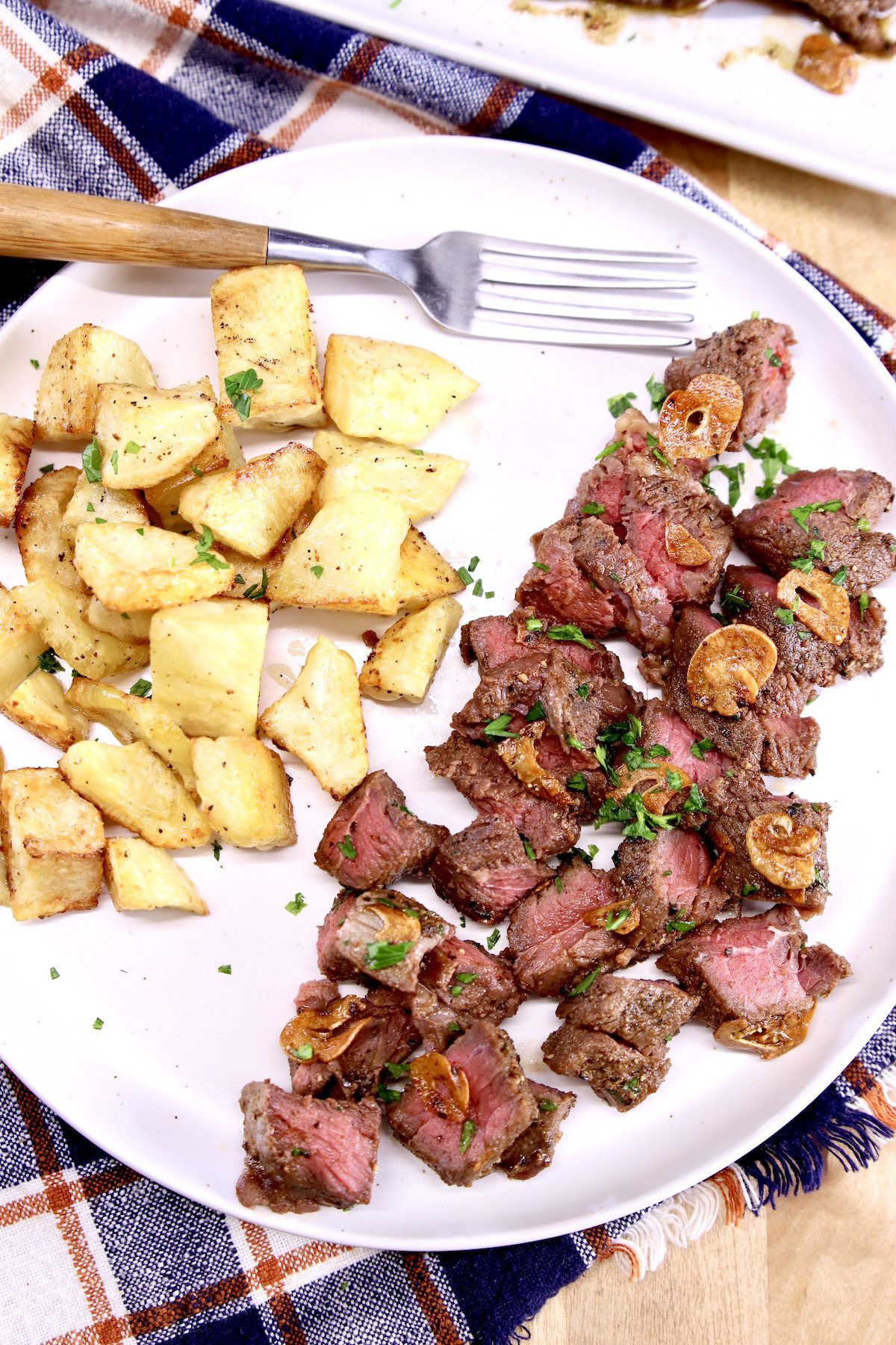steak bites and potatoes on a plate