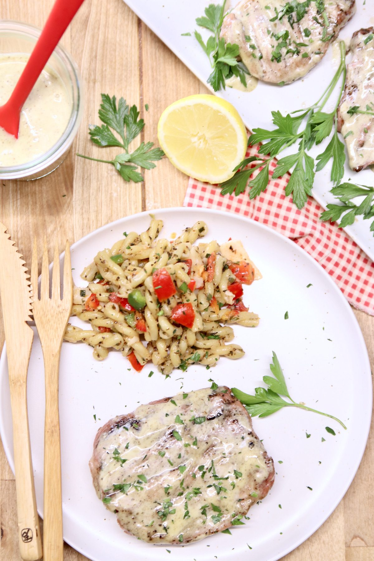 plated pork chop with pasta salad