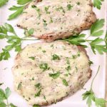 closeup of creamy Italian pork chops with parsley on a platter