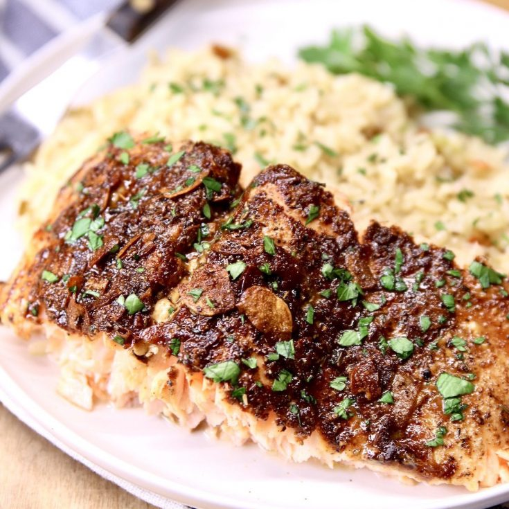 Garlic Butter Salmon slice on a plate with rice