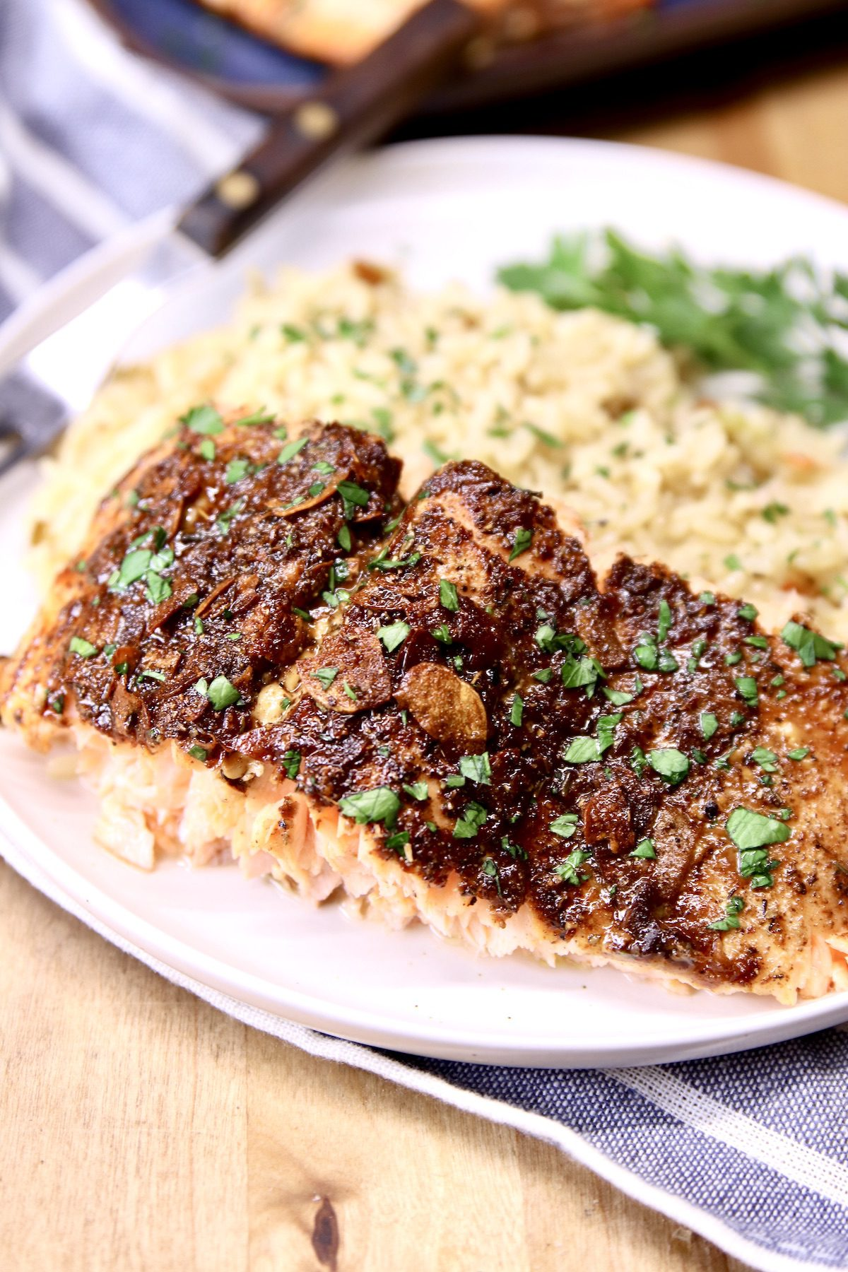 Garlic Butter Salmon slice with rice on a plate