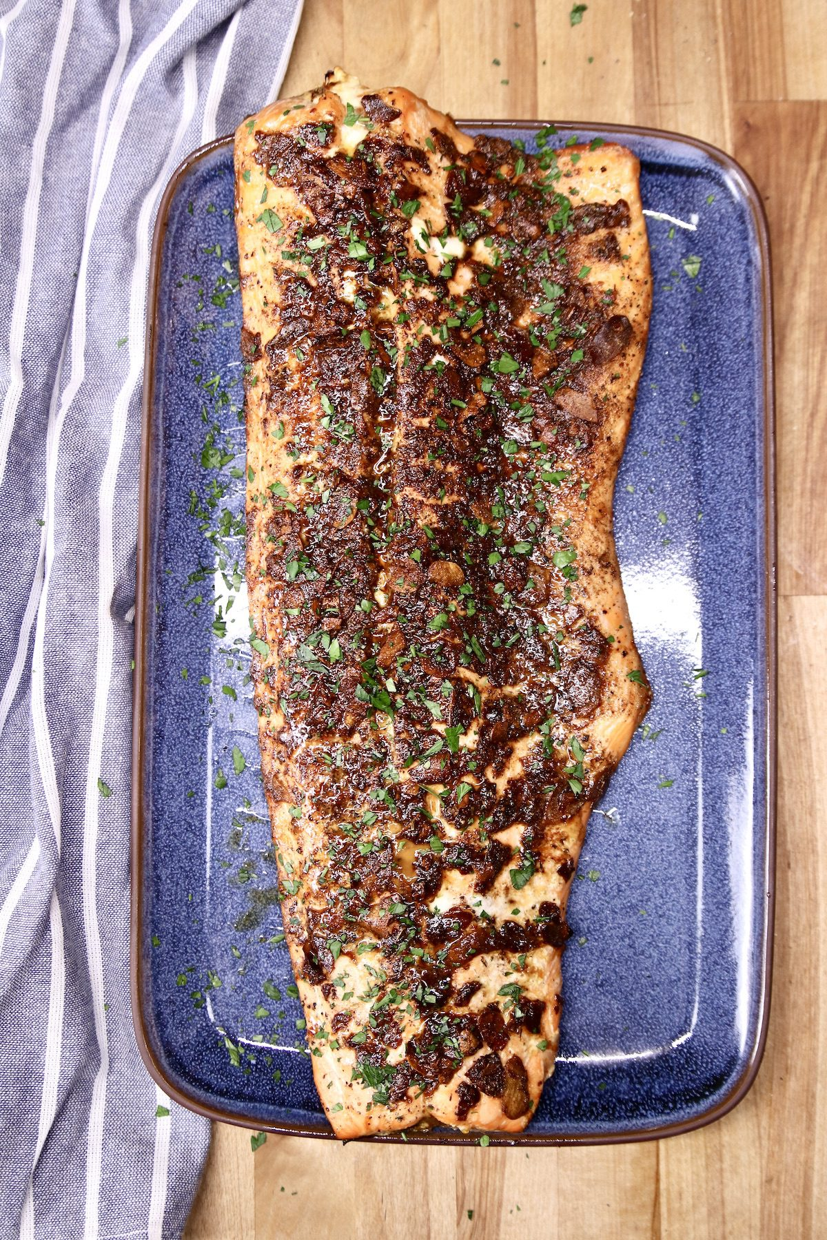 overhead view of whole salmon fillet on a blue platter