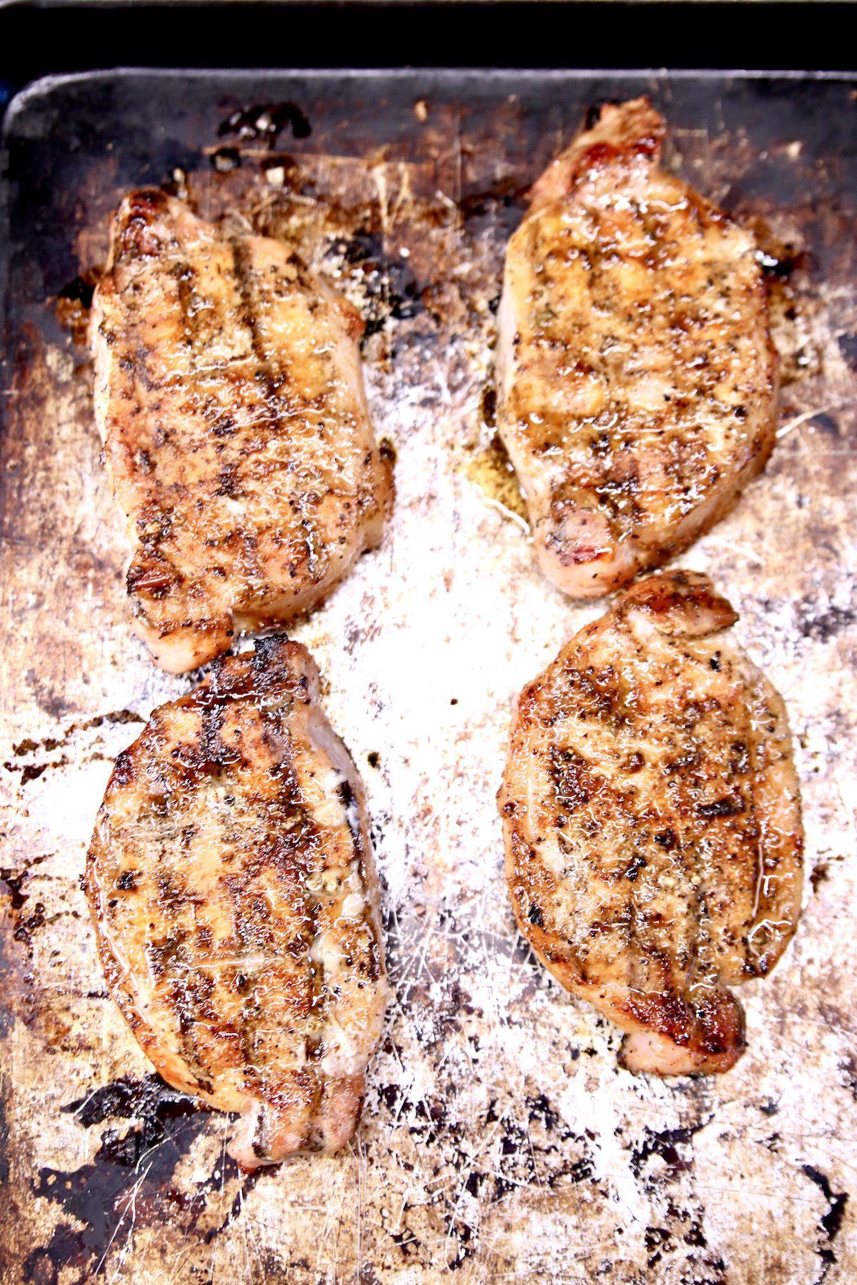 sheet pan with 4 grilled boneless pork chops