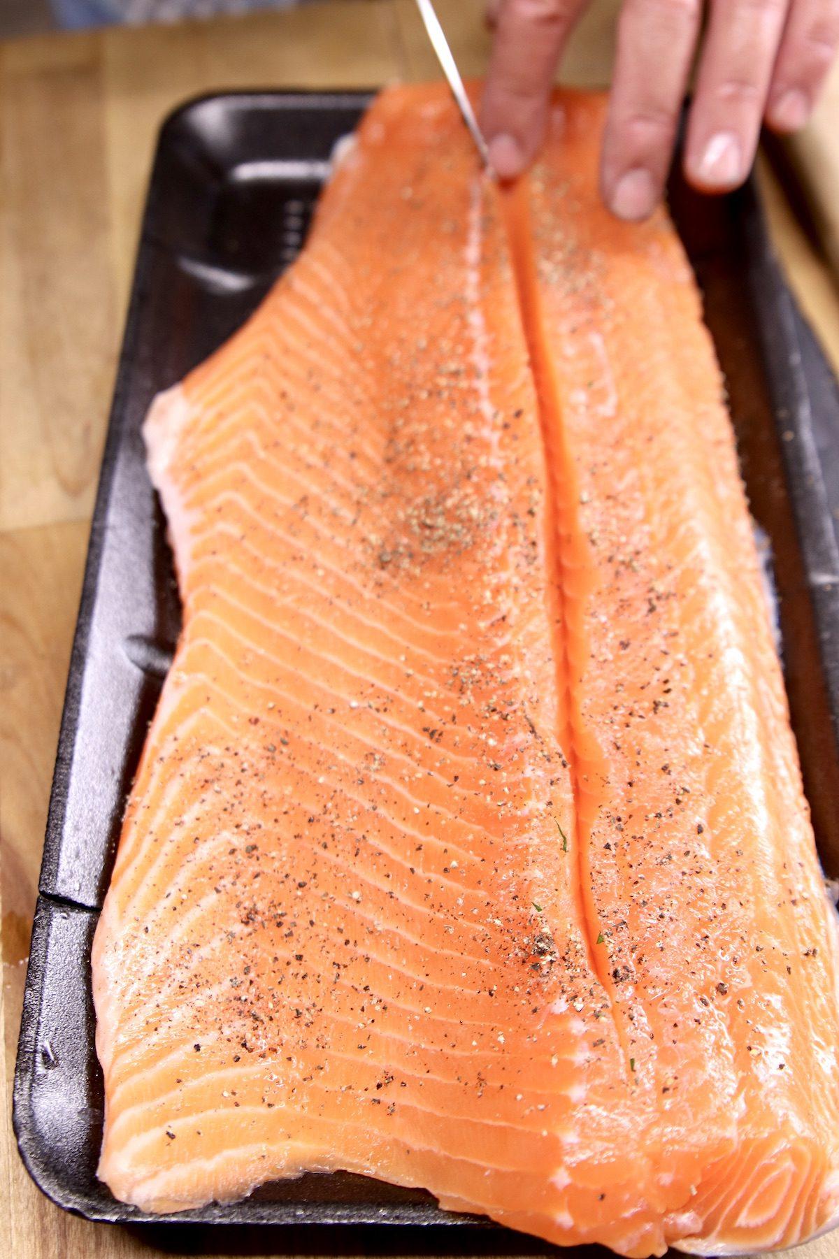 Slicing salmon lengthwise