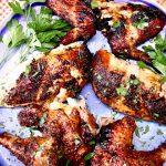 spicy chicken brine text overlay: grilled chicken pieces