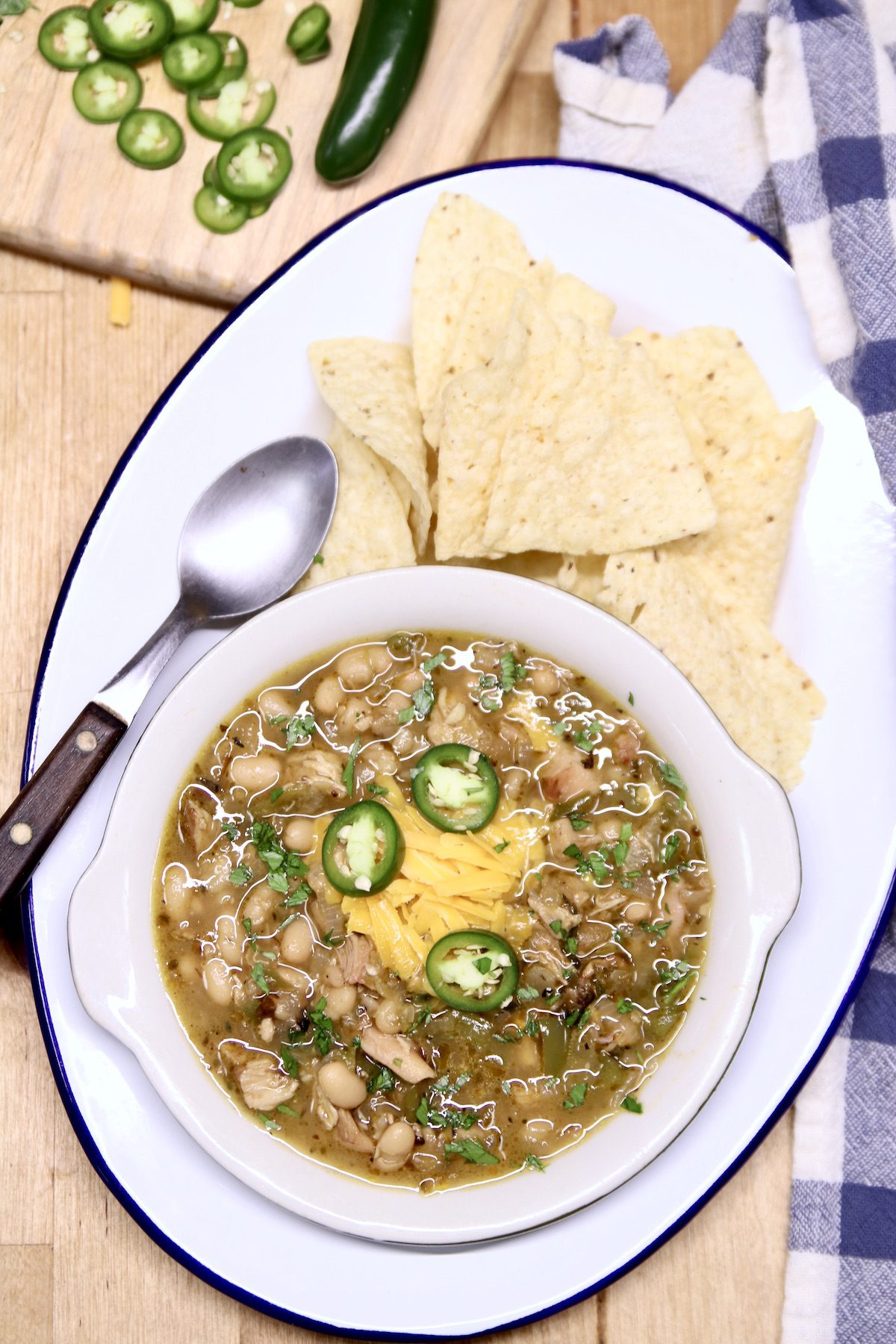platter with bowl of chicken chili, tortilla chips
