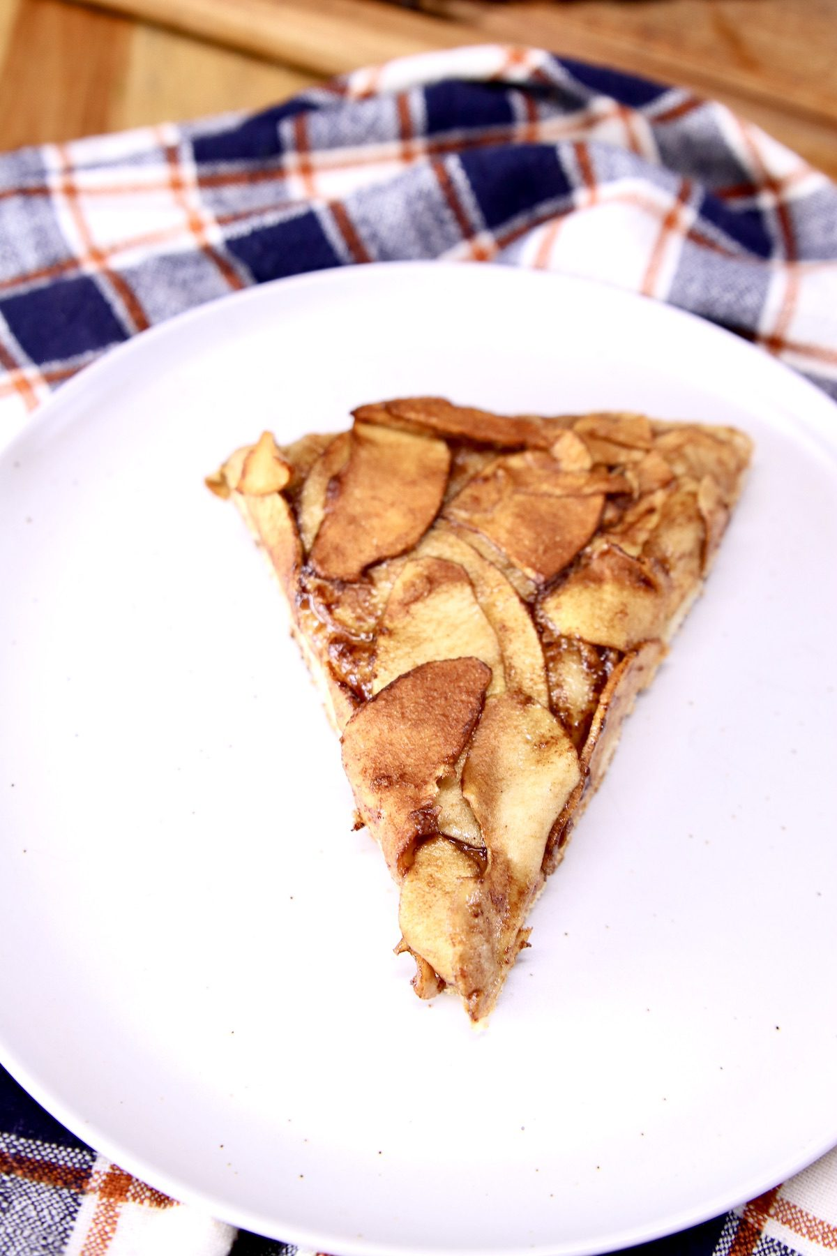 slice of apple pizza on a white plate