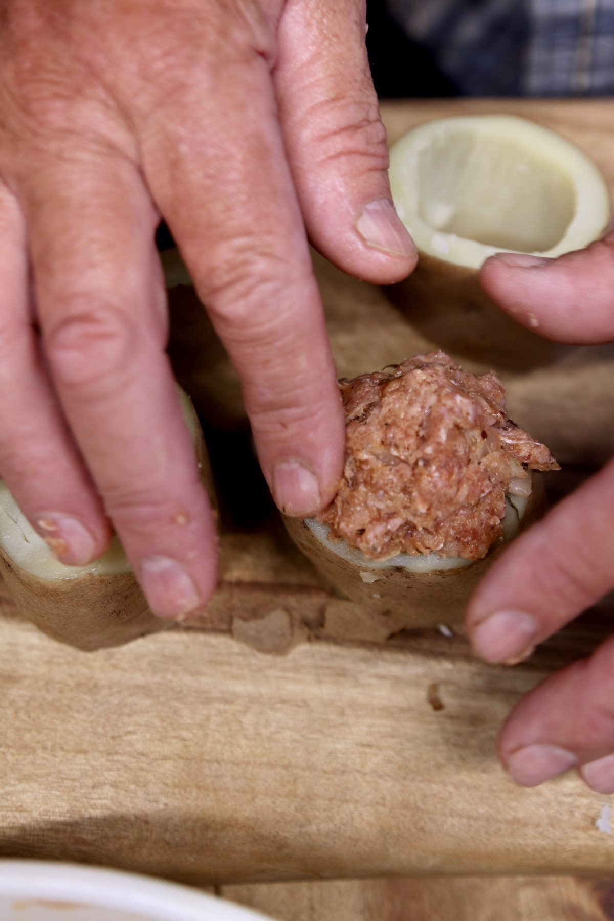 stuffing meatloaf into potato rounds