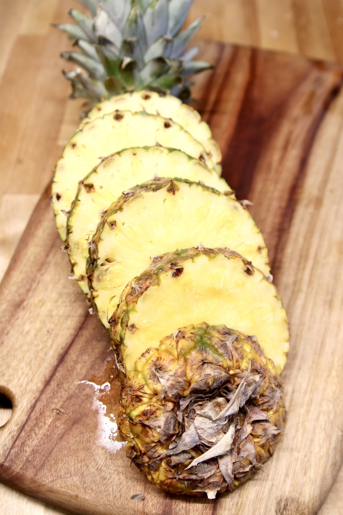 fresh pineapple with the ends- sliced into rounds