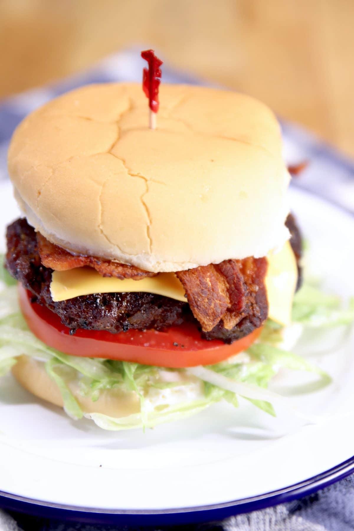 bacon cheeseburger on a plate