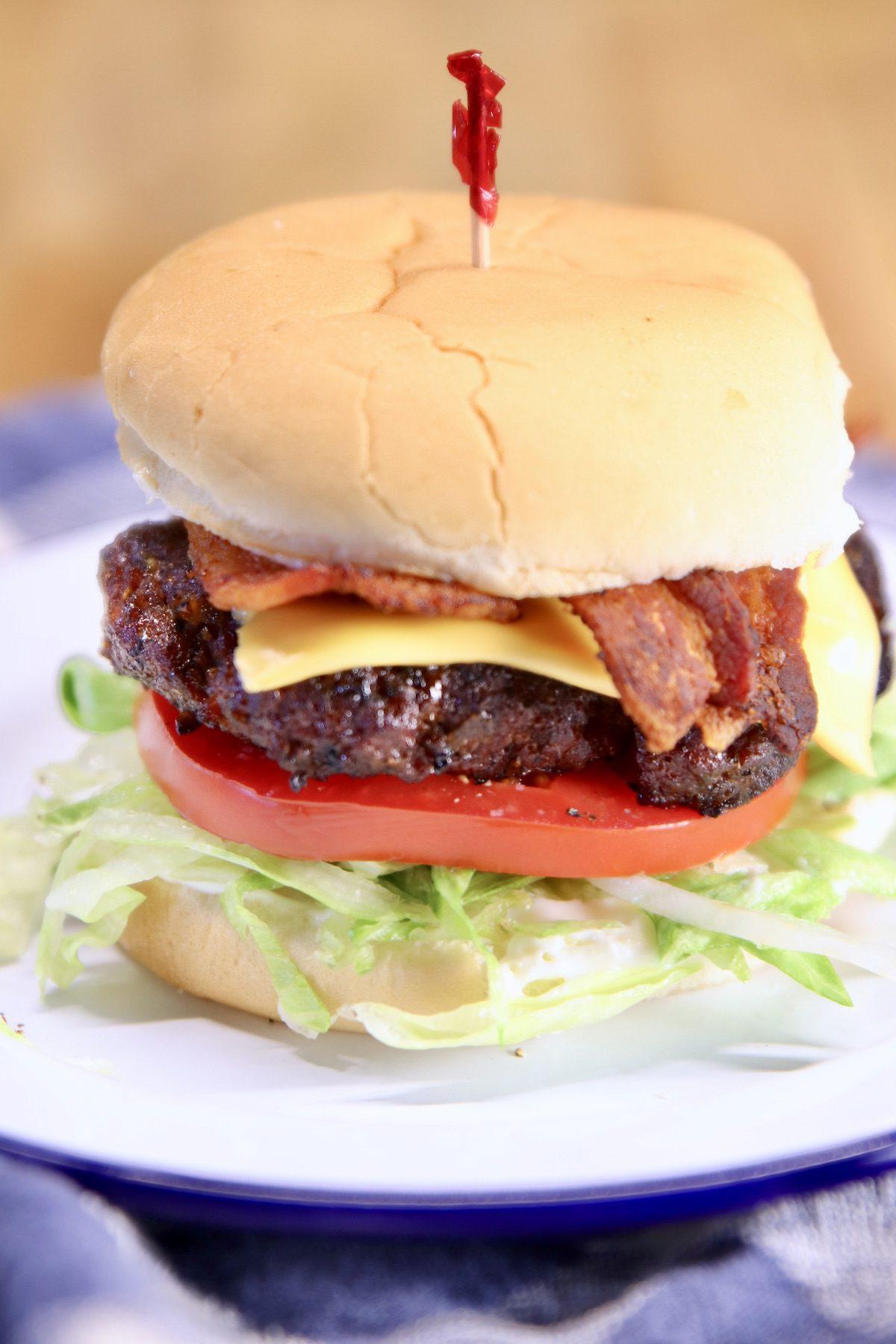 bacon cheeseburger on a plate - closeup