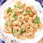 bowl of grilled garlic butter shrimp with parsley