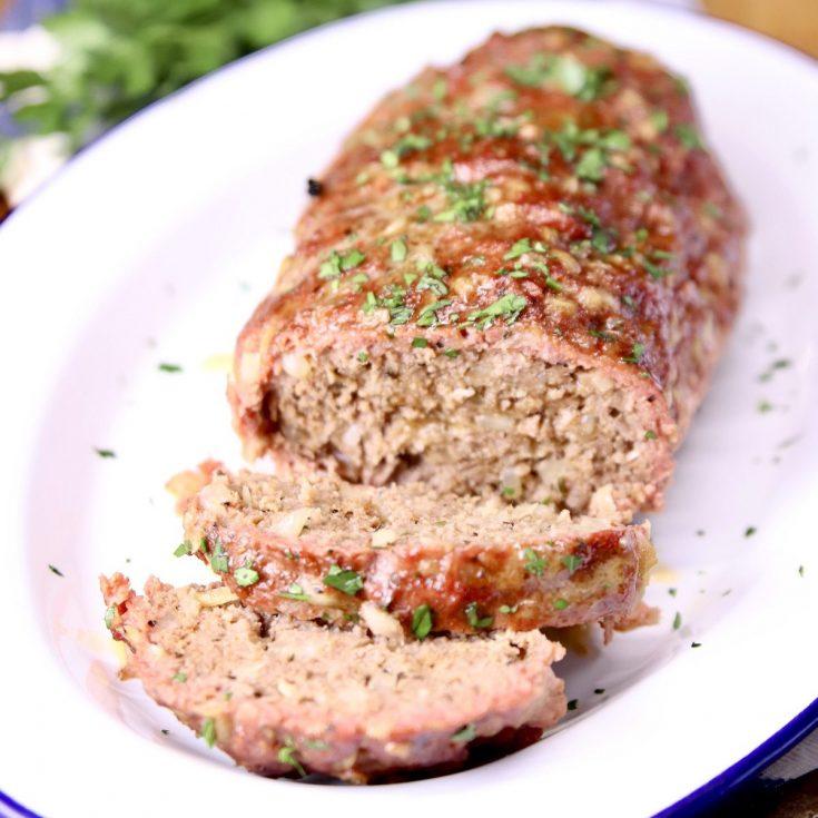 Grilled meatloaf on a platter, 2 slices