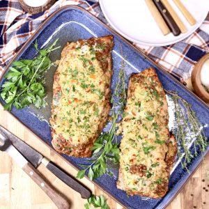 blue platter with 2 rice stuffed pork tenderloins