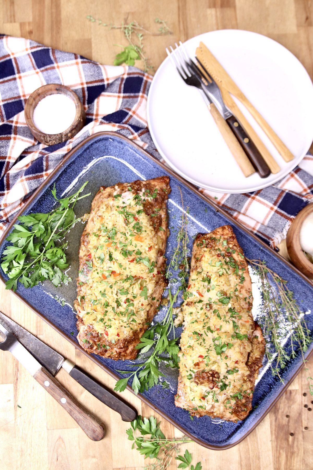 pork tenderloins on a platter, plates, forks
